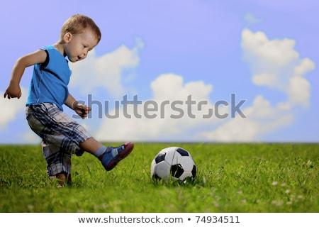Stok fotoğraf: Erkek · top · çayır · gökyüzü · çim · futbol