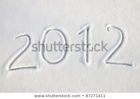 Written word 2012 on a snow field Stock photo © zurijeta