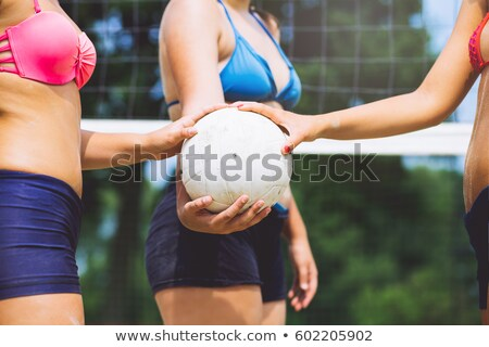 close up of woman with volleyball ball on beach Stock photo © dolgachov