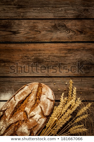 Rustic bread and wheat on an old vintage planked wood rustic tab stock photo © Yatsenko