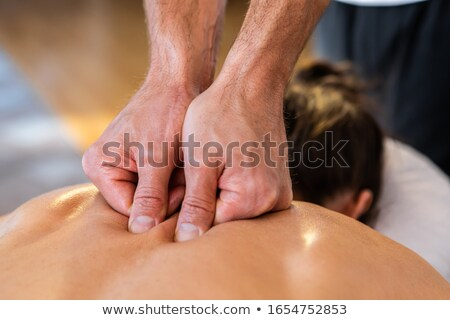 physiotherapist giving hand massage to a girl stock photo © wavebreak_media
