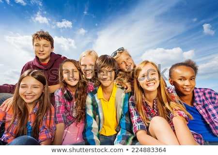 Teen group sitting on grass Stock photo © IS2