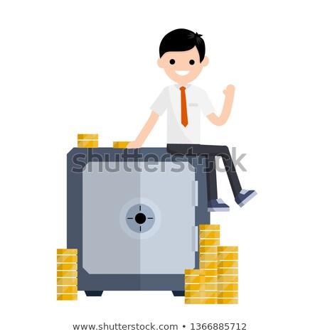 european businessman sitting on bank safe stock photo © studioworkstock