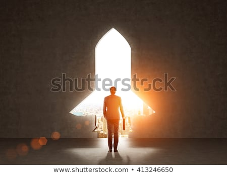 Concept of startup with a rocket shape hole in the wall which alludes to the departure towards new g Stock photo © alphaspirit