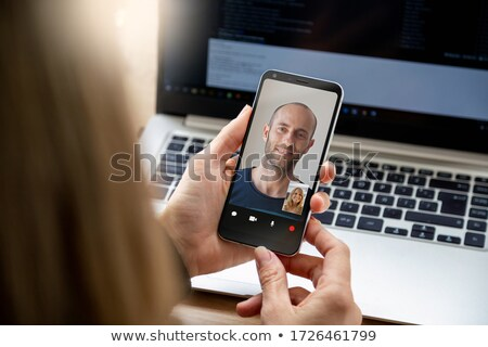 man with smartphone having video call at office stock photo © dolgachov