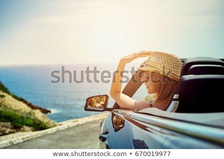 Młodych atrakcyjna kobieta dysk kabriolet widoku Zdjęcia stock © boggy