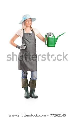 image of caucasian woman gardener 20s wearing apron standing wit stock photo © deandrobot