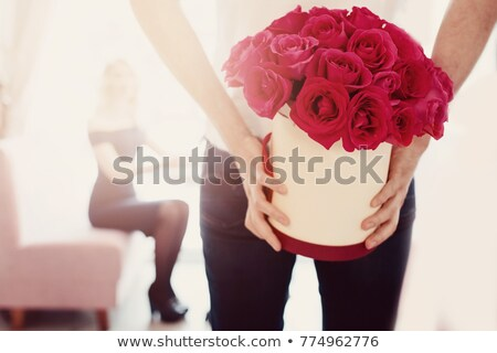 happy woman hugging flower bouquet roses in box stock photo © robuart