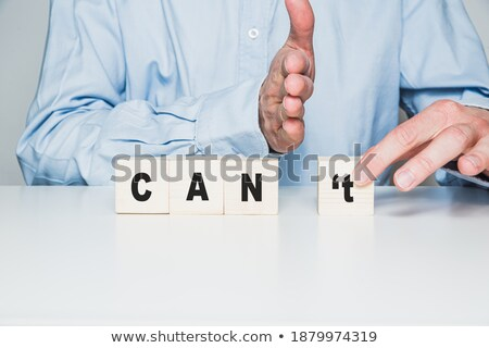 Person's Hand Separating 't' From The We Can Blocks Stock photo © AndreyPopov