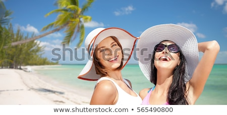 friends in sunglasses over exotic beach background Stock photo © dolgachov