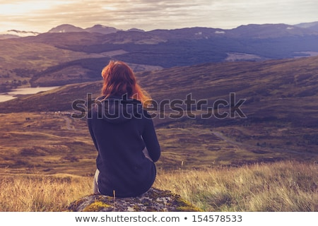 Woman in the mountain wilderness Stock photo © lovleah