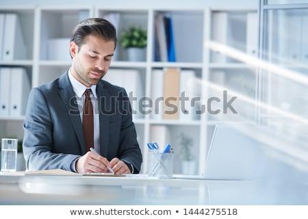 Sério analista escrita para baixo trabalhando pontos Foto stock © pressmaster