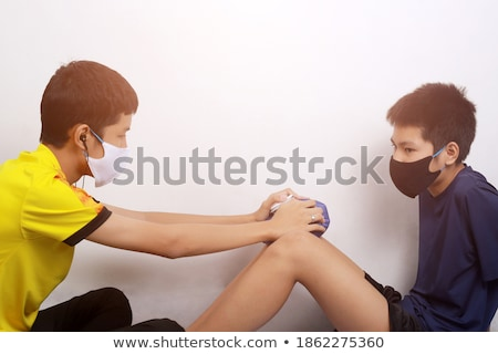 Man Wearing Knee Ice Pack Stock photo © AndreyPopov