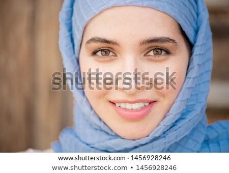 Giovani serena femminile blu hijab guardando Foto d'archivio © pressmaster