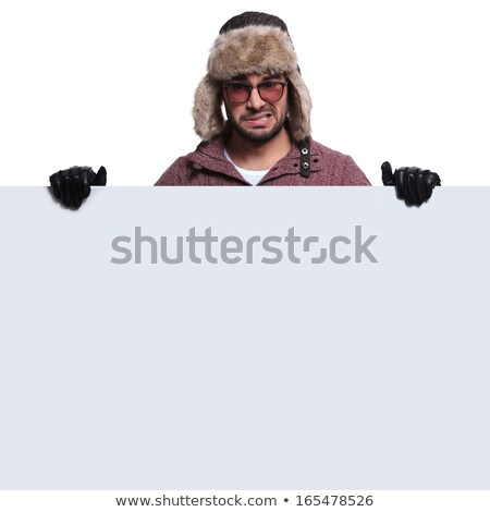 Angry man presenting white blank panel. Stock photo © lichtmeister
