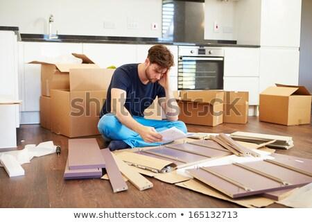 Hayal kırıklığına uğramış adam birlikte mobilya çalışmak ev Stok fotoğraf © galitskaya