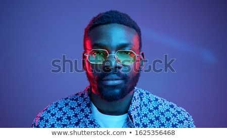 portrait of handsome futuristic style man looking at camera agai stock photo © hasloo