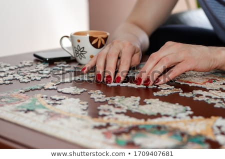 Family completing a puzzle together Stock photo © photography33