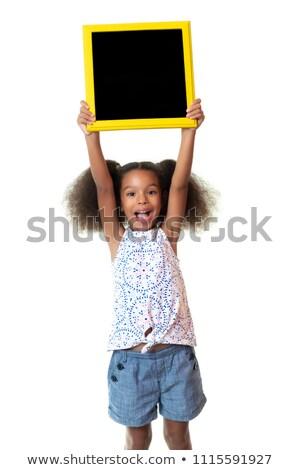 child kid happy girl holding blank blackboard copyspace stock photo © lunamarina