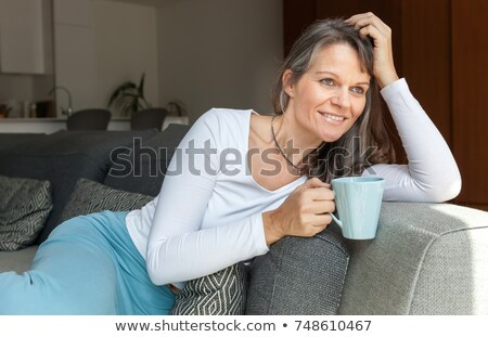 Grey-haired lady drinking her morning coffee Stock photo © photography33