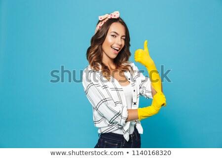 Indossare guanti di pulizia bianco felice Foto d'archivio © wavebreak_media
