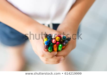 close up of girl holding pencil stock photo © zzve