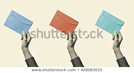 postman holding envelope stock photo © kirill_m
