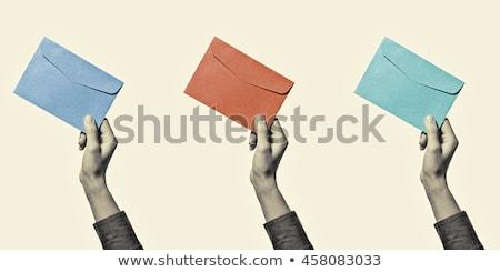 Postás tart boríték izolált fehér üzlet Stock fotó © Kirill_M