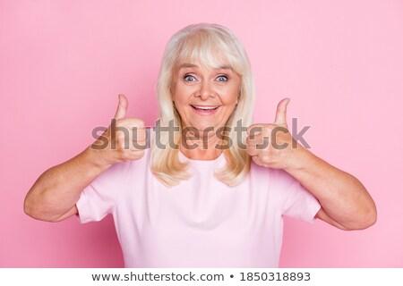 Mulher madura assinar tanto mãos Foto stock © bmonteny