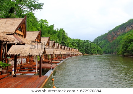 floating house in river kwai in thailand stock photo © frameangel