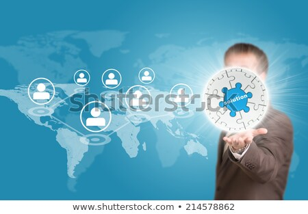 business man hold puzzle sphere with success label stock photo © cherezoff