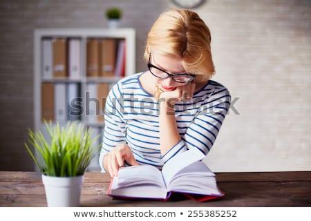 business woman reading book stock photo © fuzzbones0