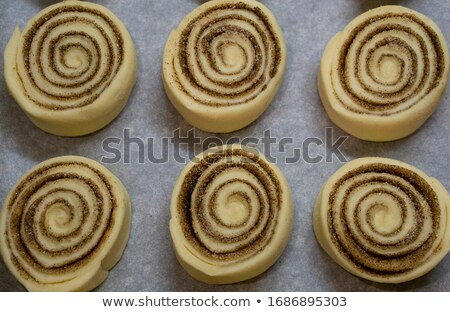 Raw cinnamon buns ready to bake with selective focus. Stock photo © rojoimages