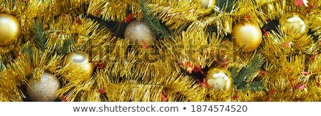 Gold Christmas balls hanging on dark wooden background Stock photo © Valeriy