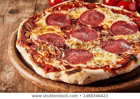 Salame pizza isolado branco refeição fast-food Foto stock © Digifoodstock