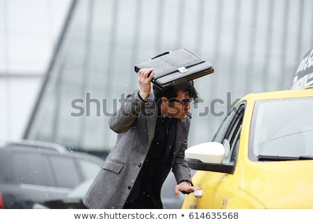 A man getting soaked in the rain Stock photo © IS2