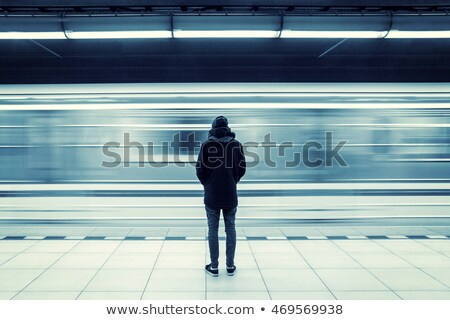 Commuter standing on a platform Stock photo © IS2