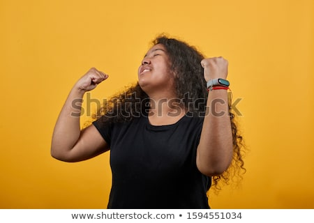 Attractive overweight woman grimacing Stock photo © Traimak