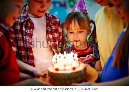 Pretty child looking at tasty birthday cake  Stock photo © dashapetrenko