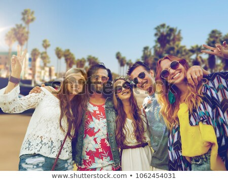 happy friends in sunglasses over venice beach Stock photo © dolgachov