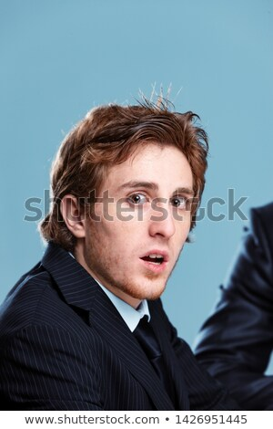 Shocked businessman turning to gawp at the camera Stock photo © Giulio_Fornasar