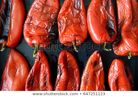 Stockfoto: Roasted Red Peppers In Black Tray