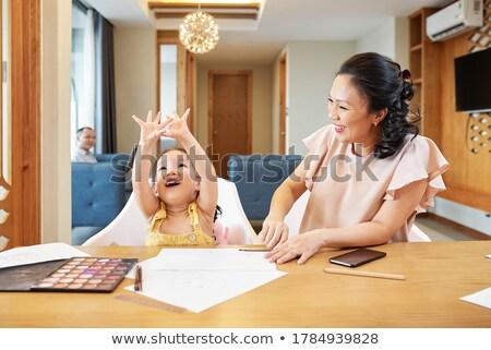 Cute daughter describing drawing Stock photo © pressmaster