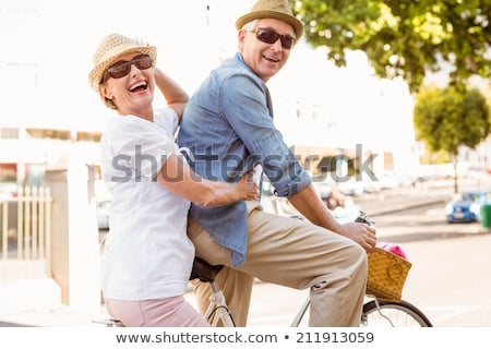 Side view of active senior couple riding a bicycle on the beach Stock photo © wavebreak_media