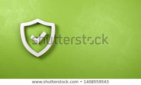 Shield Symbol Shape on Green Plastered Wall Stock photo © make