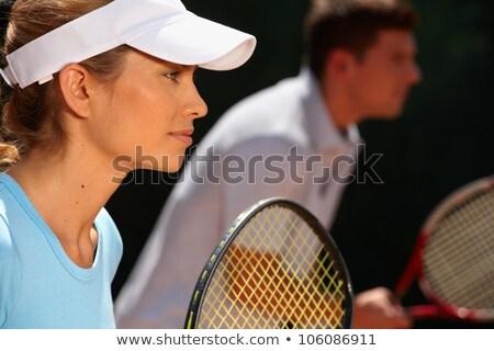 Kép gyönyörű férfi nő játszik tenisz Stock fotó © deandrobot