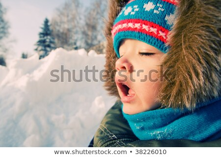 Young boy want to sneeze outdoor. Stock photo © Lopolo
