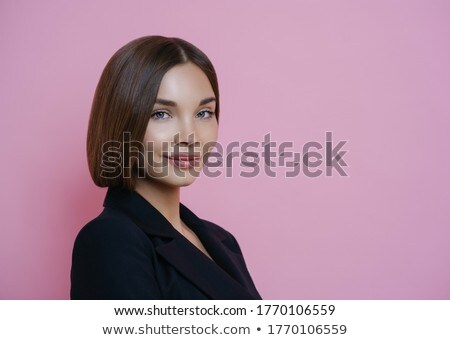Profile shot of dark haired woman dressed in black suit, has natural makeup, looks self assured indo Stock photo © vkstudio