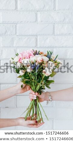 Woman receiving bouquet of flowers Stock photo © photography33