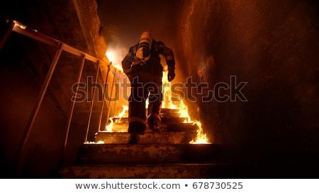 Dois bombeiros trabalhar trabalhando enorme fogo Foto stock © tomistajduhar